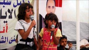 Children singing in Change Square