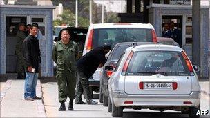 Tunisian soldier checks vehicles on the Tunisian-Libyan border in Dehiba in April 2011