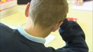 Boy taking a test