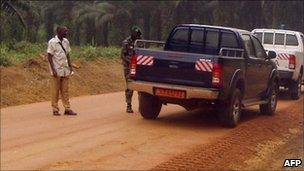 Cars on a dust road in Cameroon (archive shot)