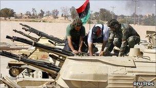 Libyan rebels with a captured tank in Zintan, 25 June 2011