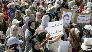 Protesters shout anti-government slogans during a rally organised by the 20 February Movement against a proposed new constitution in Casablanca, Morocco, Sunday 26 June 2011