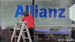 Man fixing Allianz sign