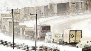 Traffic in snow storm (Image: PA)