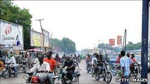 Motorbikes on a road in Maiduguri (July 2010)