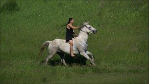 A woman riding a horse at Fort Berthold Reservation