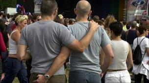 Gay men with their arms around each other