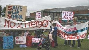 Parents and pupils protesting over plans to merge Ifton Heath primary - archive image