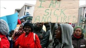 Protesters with placards in Mbabane (27 July)