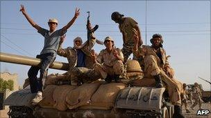 Libyan rebels celebrate after capturing Ghazaya, 28 July 2011