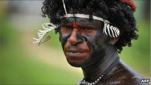 a Papuan tribesman participating in the Lake Sentani festival in the Jayapura district June 2011