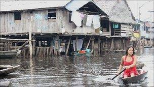 A woman in a canoe in Iquitos