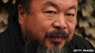 Chinese artist Ai Weiwei under house arrest in the courtyard of his home in Beijing (November 2010)