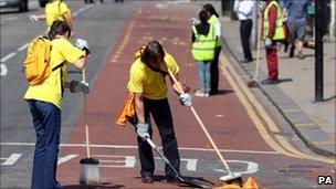 Volunteers help the clean-up effort in Croydon