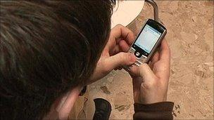 Generic image of a boy using a phone