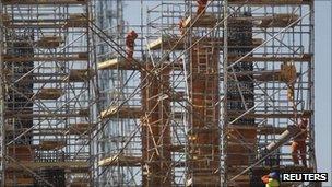 Employees work on the reconstruction of Mane Garrincha stadium in Brasilia, 18 August 2011