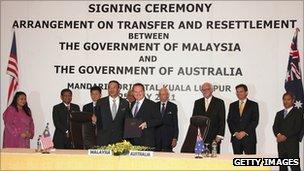 "Australian Immigration Minister Chris Bowen and Malaysia Home Minister YB Seri Hishammuddin Tun Hussein pose after signing the ""transfer and settlement"" agreement between Malaysia and Australia on 25 July in Kuala Lumpur, Malaysia"