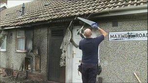 Workman repairing bungalow