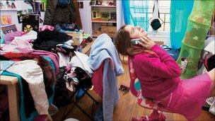 Student in messy room