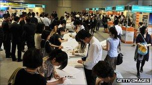 Applicants at a jobs fair in Hong Kong