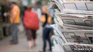 Newspaper rack on street