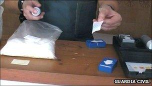 Guardia Civil officer with seized drugs