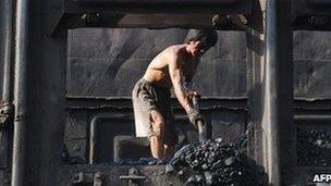 Man shovelling coal