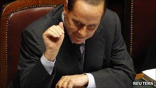 Italy's Prime Minister Silvio Berlusconi gestures during a debate in the upper house of parliament in Rome