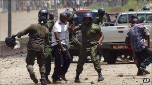 Paramilitary police clash with a bodyguard of opposition leader Cellou Dalein Diallo, after stopping Diallo's convoy on the way to a protest march in Conakry, Guinea, on 27 Sept