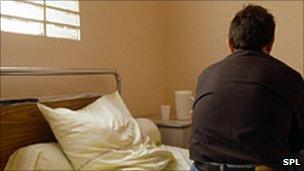 Man sitting on a bed