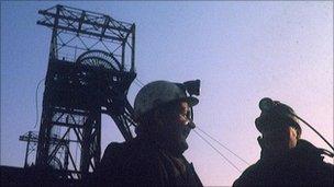 A coal mine and miners