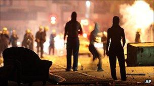 (File photo: September 2011) Protesters fight with police on the outskirts of Bahrain's capital
