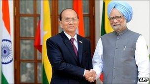 President of Myanmar U Thein Sein (L) shakes hands with Indian Prime Minister Manmohan Singh (R) in New Delhi on October 14, 2011