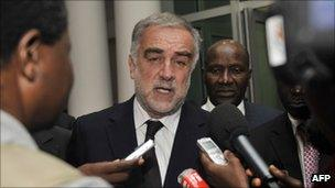 """The International Criminal Court""""s chief prosecutor, Luis Moreno-Ocampo (L) at the Prime Minister's residence in Abidjan on October 14, 2011."""
