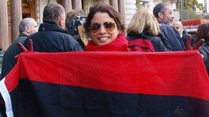 A woman celebrates outside the Libyan embassy in London, on October 20, 2011