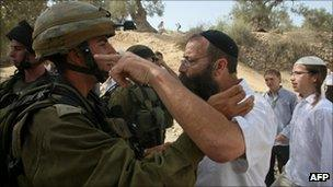 A Jewish settler from the occupied West Bank city of Hebron argues with an Israeli soldier