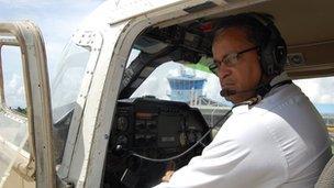 Captain Gouveia in an airplane cockpit