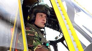 Prince William in his helicopter