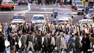 File image of residents and workers crossing the street in Tokyo