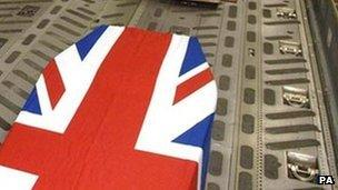 Coffin draped in Union Jack flag