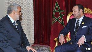 Abdelilah Benkirane (L), secretary general of the Justice and Development Party meets Morocco's King Mohammed VI in Midelt, 29 November 2011