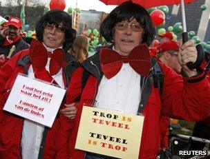 Protesters dressed as Elio Di Rupo demonstrate in Brussels, 2 December