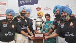 The winning team Sherdils receive the trophy