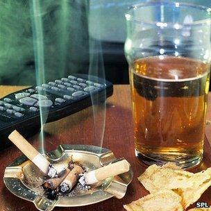 Pint of beer and cigarette stub