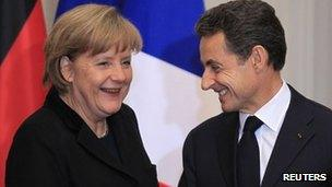 German Chancellor Angela Merkel and French President Nicolas Sarkozy after talks in Paris (5 Dec 2011)