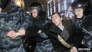 Russian police detain a protester