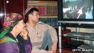 Turkmen family watch TV