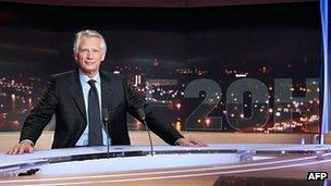 Former Prime Minister Dominique de Villepin poses prior to the start of his interview with TV channel TF1 on 11 December.