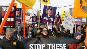 Hundreds of demonstrators march in support of Bradley Manning outside Fort Meade on Saturday 17 December 2011