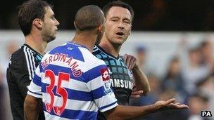 England and Chelsea captain John Terry (right) speaking with QPR's Anton Ferdinand during their teams' Premier League match at Loftus Road